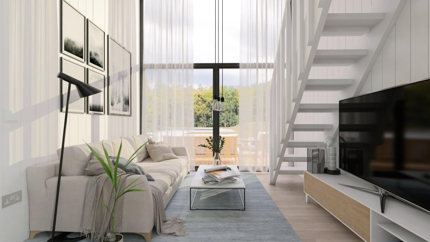 Vardagsrum med soffa, soffbord och tv i attefallshus med stort, härligt fönsterparti