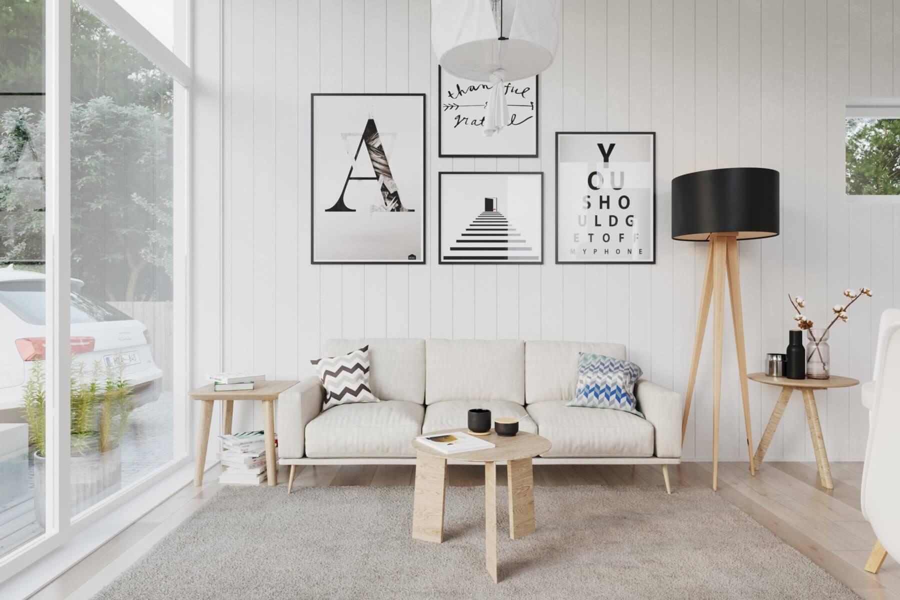 Soffhörna med soffa, soffbord, tavlor och stort fönsterpari