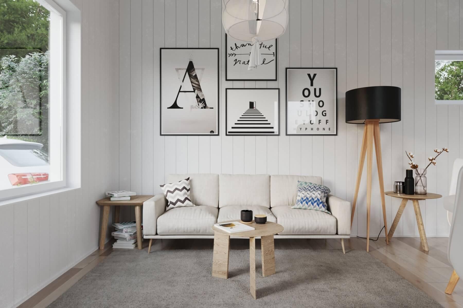 Soffhörna med soffa, soffbord och tavlor