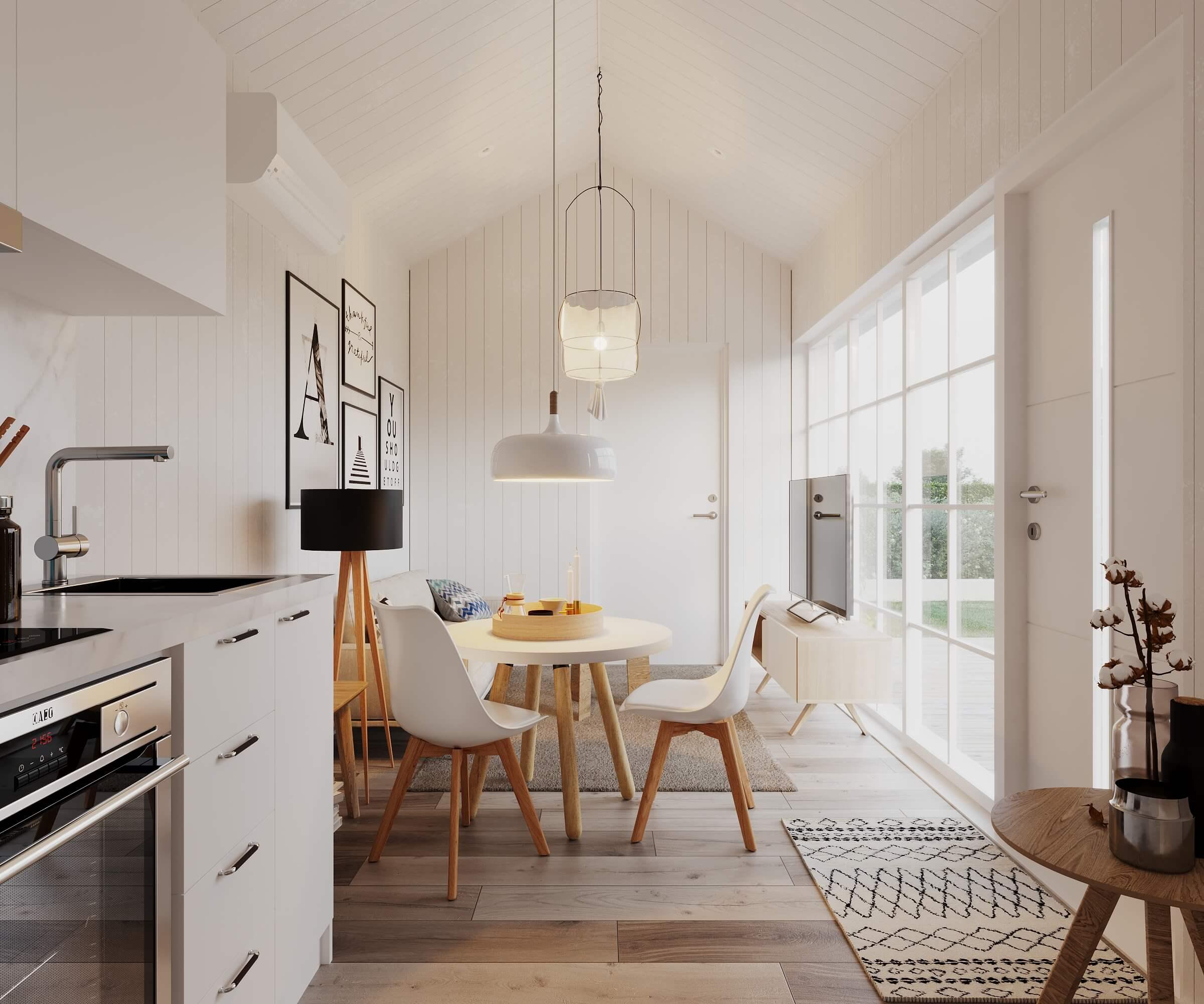 Vardagsrum med soffa, soffbord och tv stående på tv-bänk i attefallshus med klassiskt sadeltak