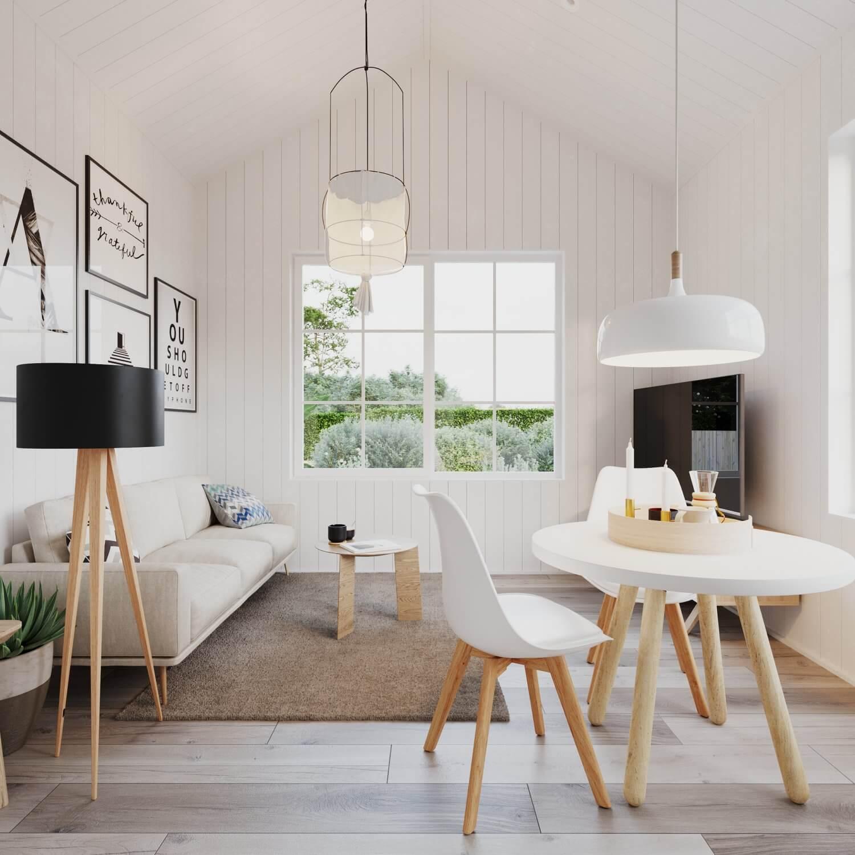 Vardagsrum i attefallshus med soffa, soffbord, tv och matbord