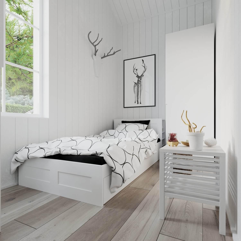 Sovrum med säng och garderob i attefallshus med klassiskt tak
