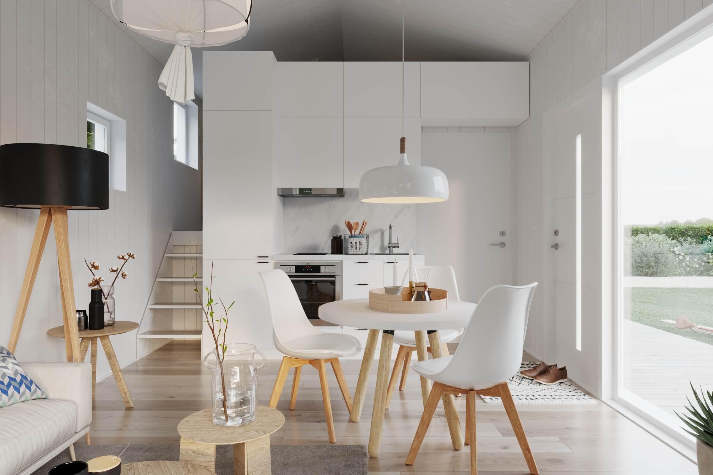 Kök med vita köksluckor, ugn, induktionshäll och panoramafönster i attefallshus med klassiskt sadeltak