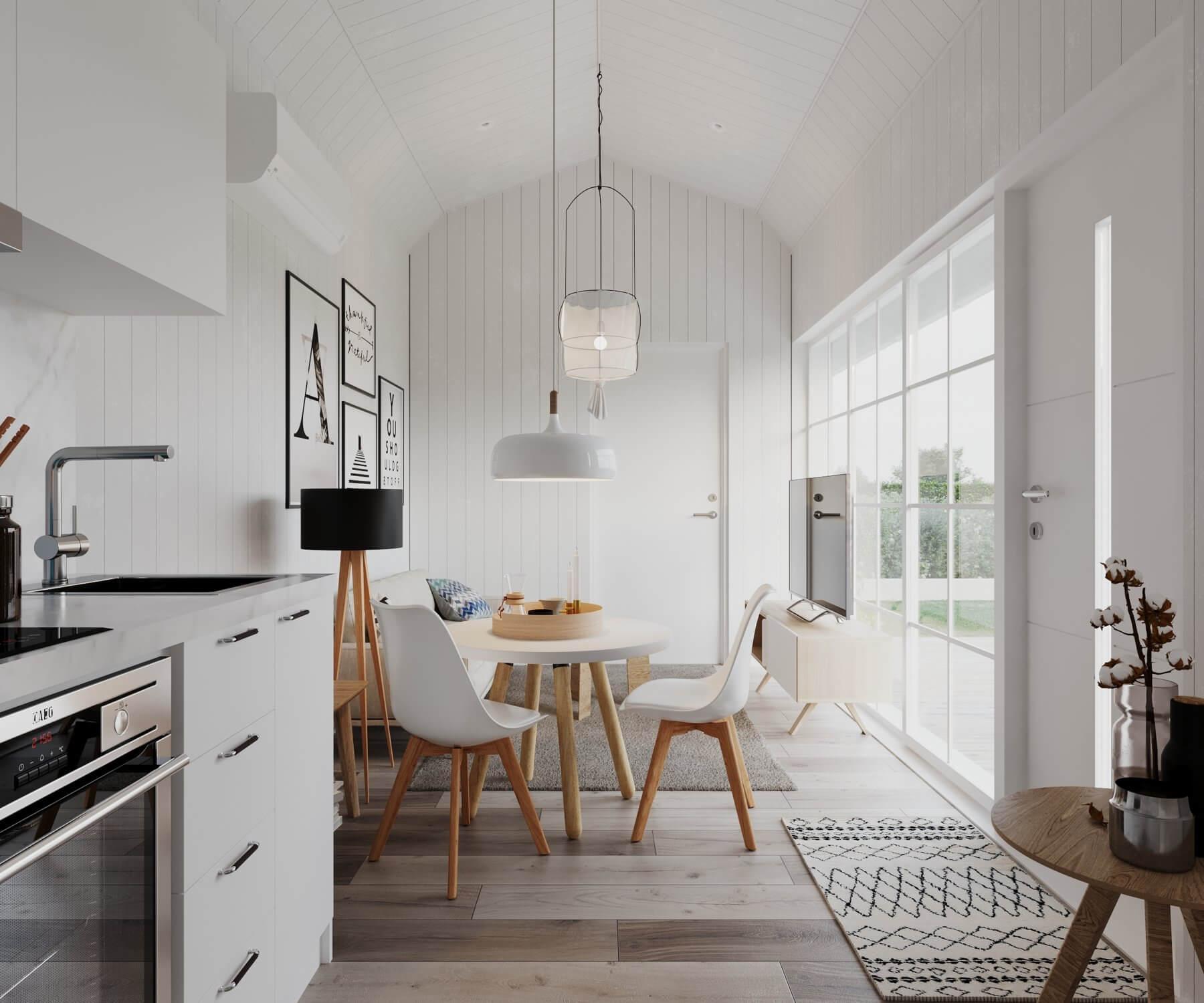 Vardagsrum med soffa, matbord och tv stående på tv-bänk i attefallshus med mansardtak