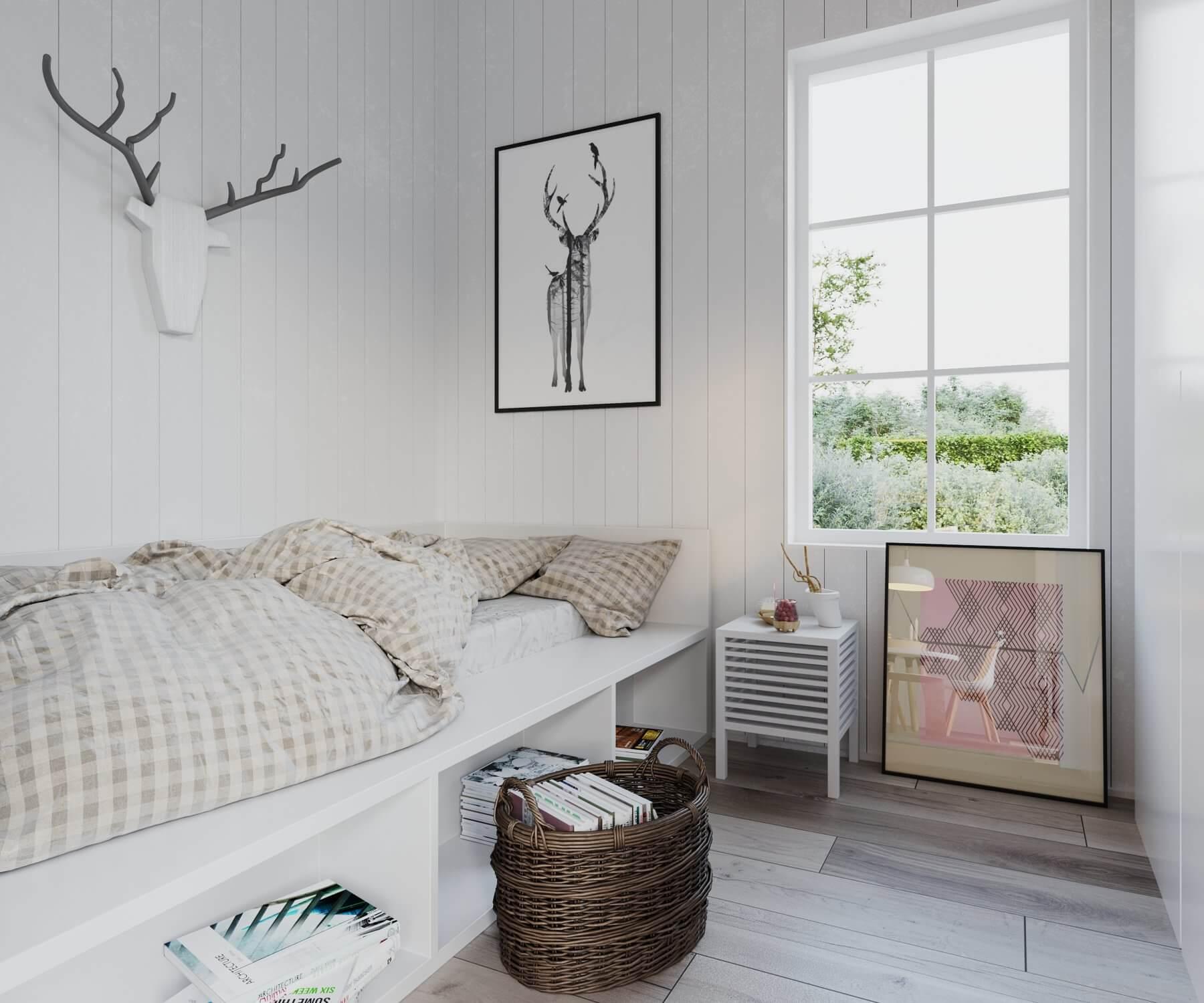 Sovrum med säng och sängbord i attefallshus med mansardtak