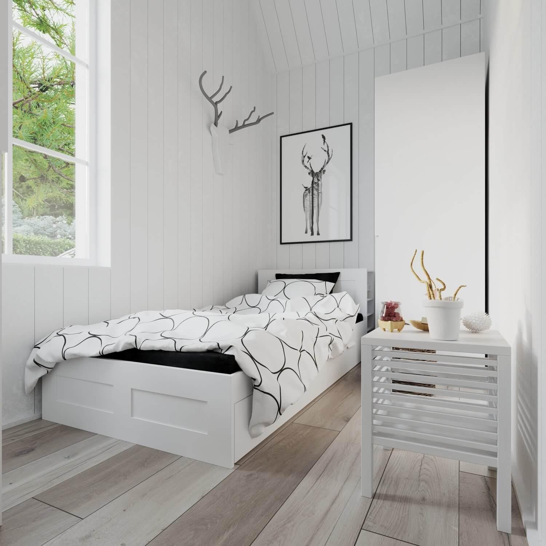Sovrum med säng och garderob i attefallshus med mansardtak och panoramafönster