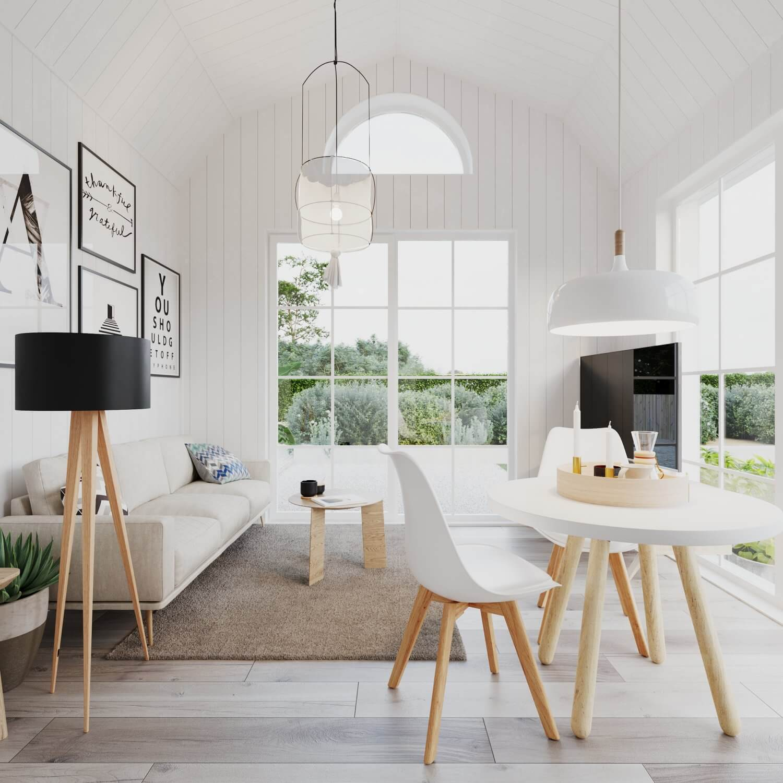 Vardagsrum med soffa, soffbord och tv i attefallshus med mansardtak och panoramafönster