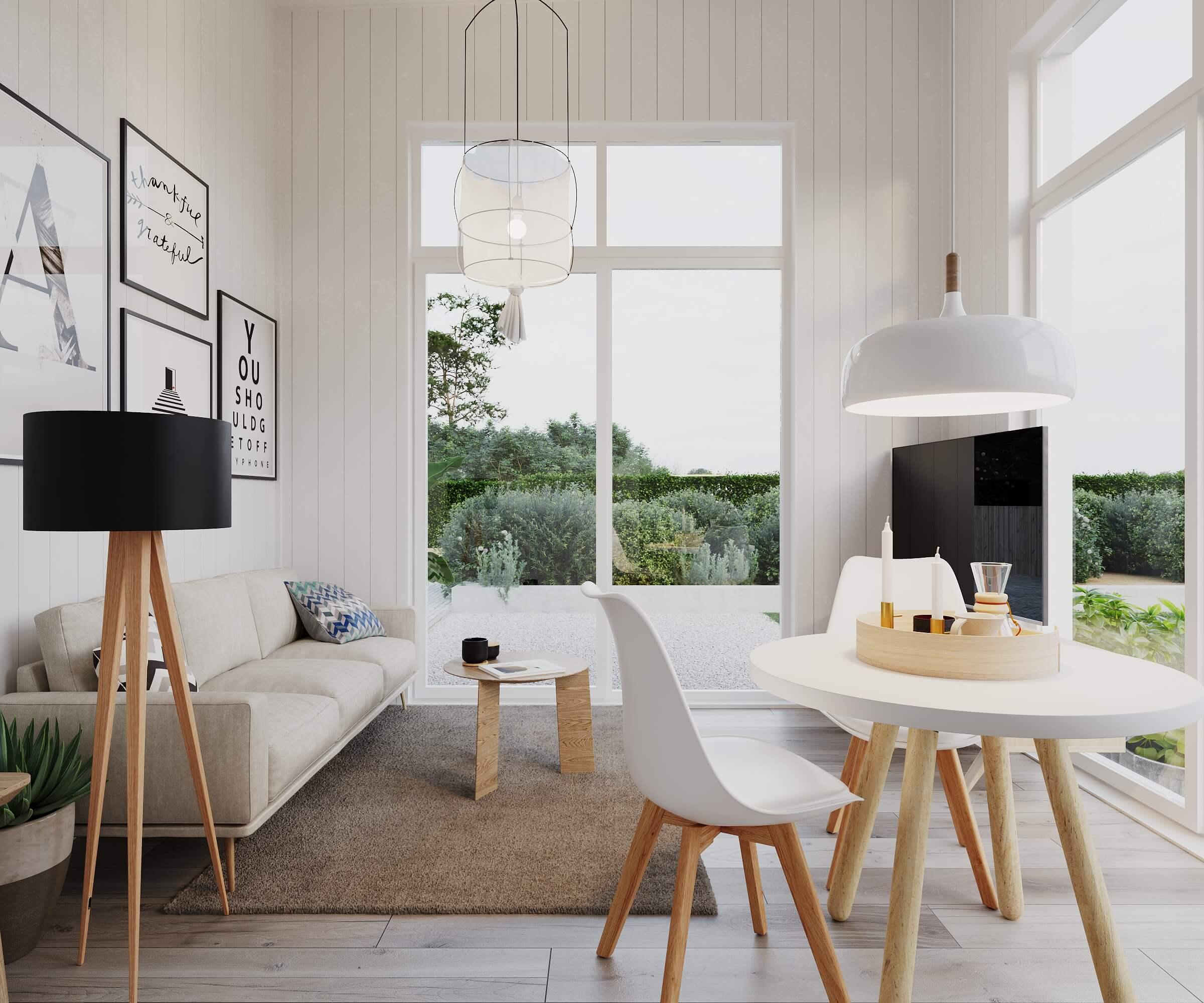 Vardagsrum med soffa, soffbord och tv i attefallshus med pulpettak och panoramafönster