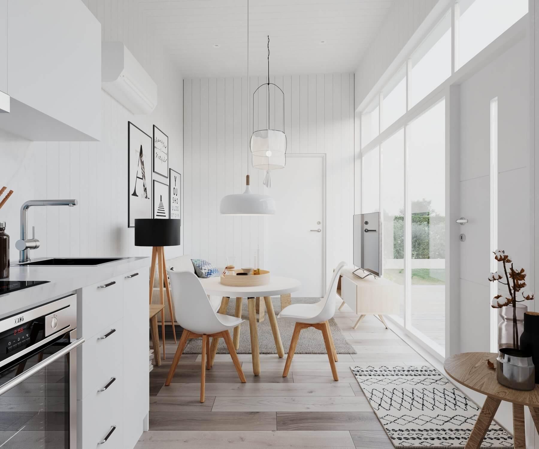 Kombinerat vardagsrum och kök i attefallshus med stora fönsterpartier