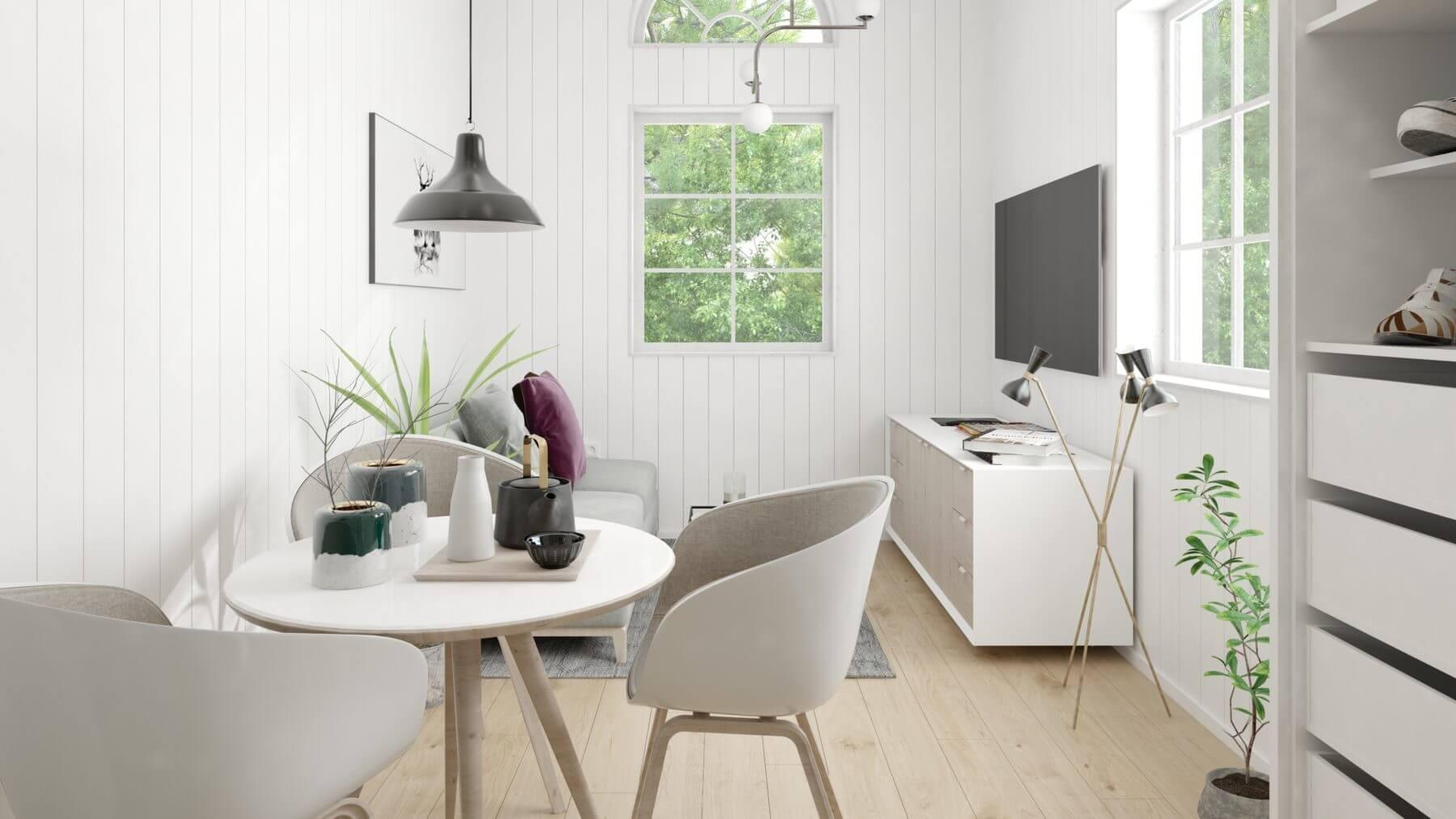 Kombinerat vardagsrum och kök i attefallshus med mansardtak