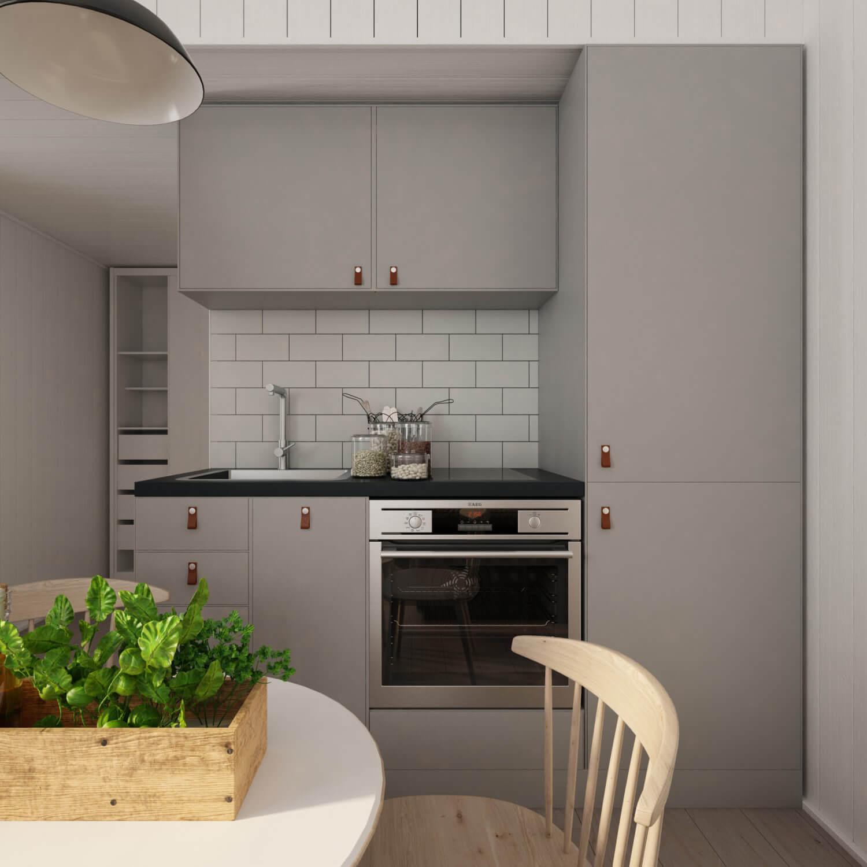Attefallshus Pulpet 25.2 kök med gråa köksluckor, ugn och induktionshäll