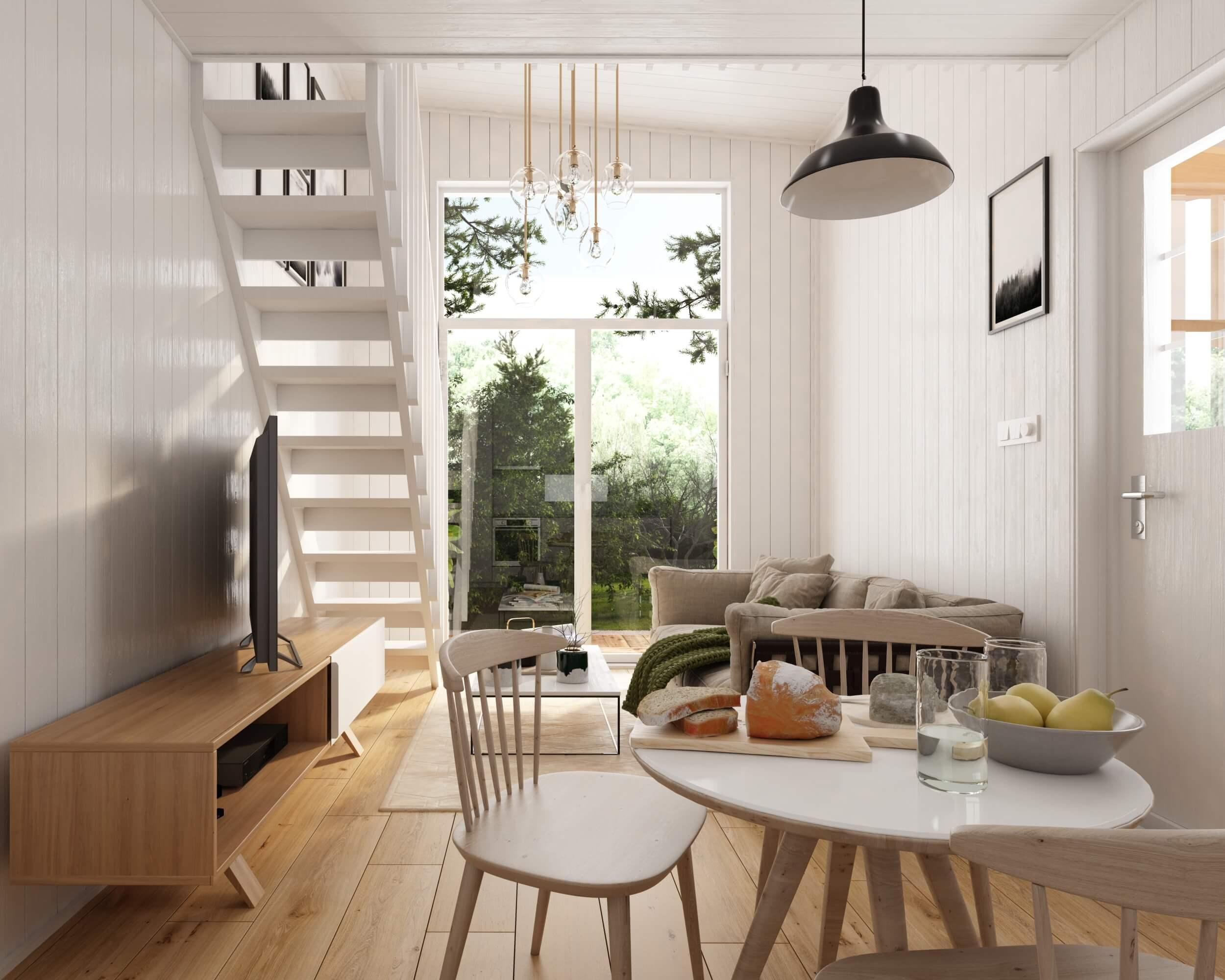 Allrum med soffta, matbord och trappa upp till loft i Attefallshus med pulpettak
