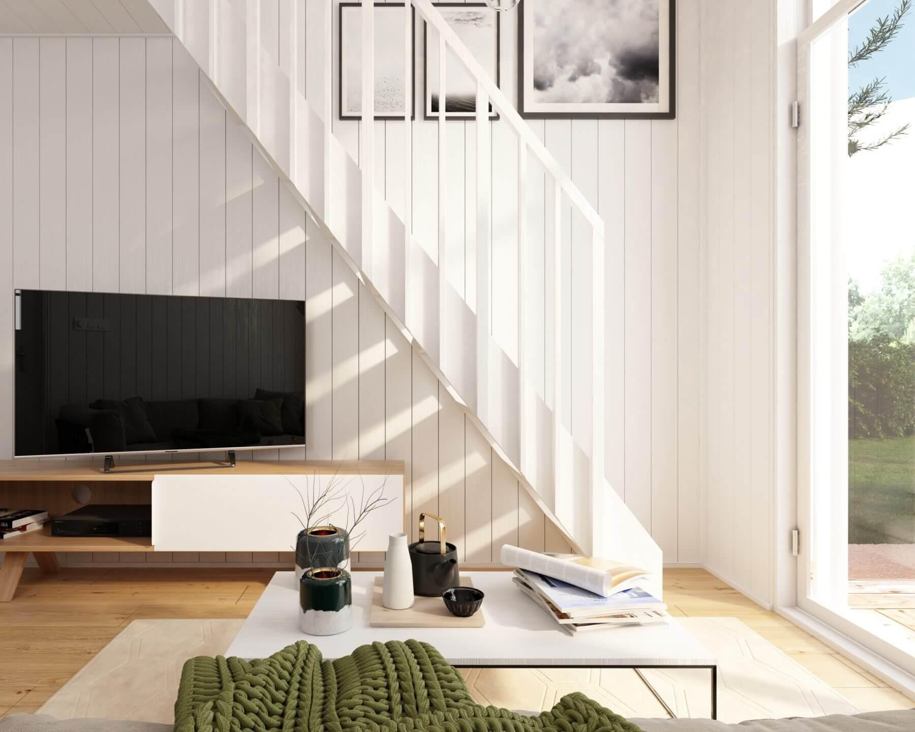 Trappa från vardagsrum upp till loft i Attefallshus med pulpettak