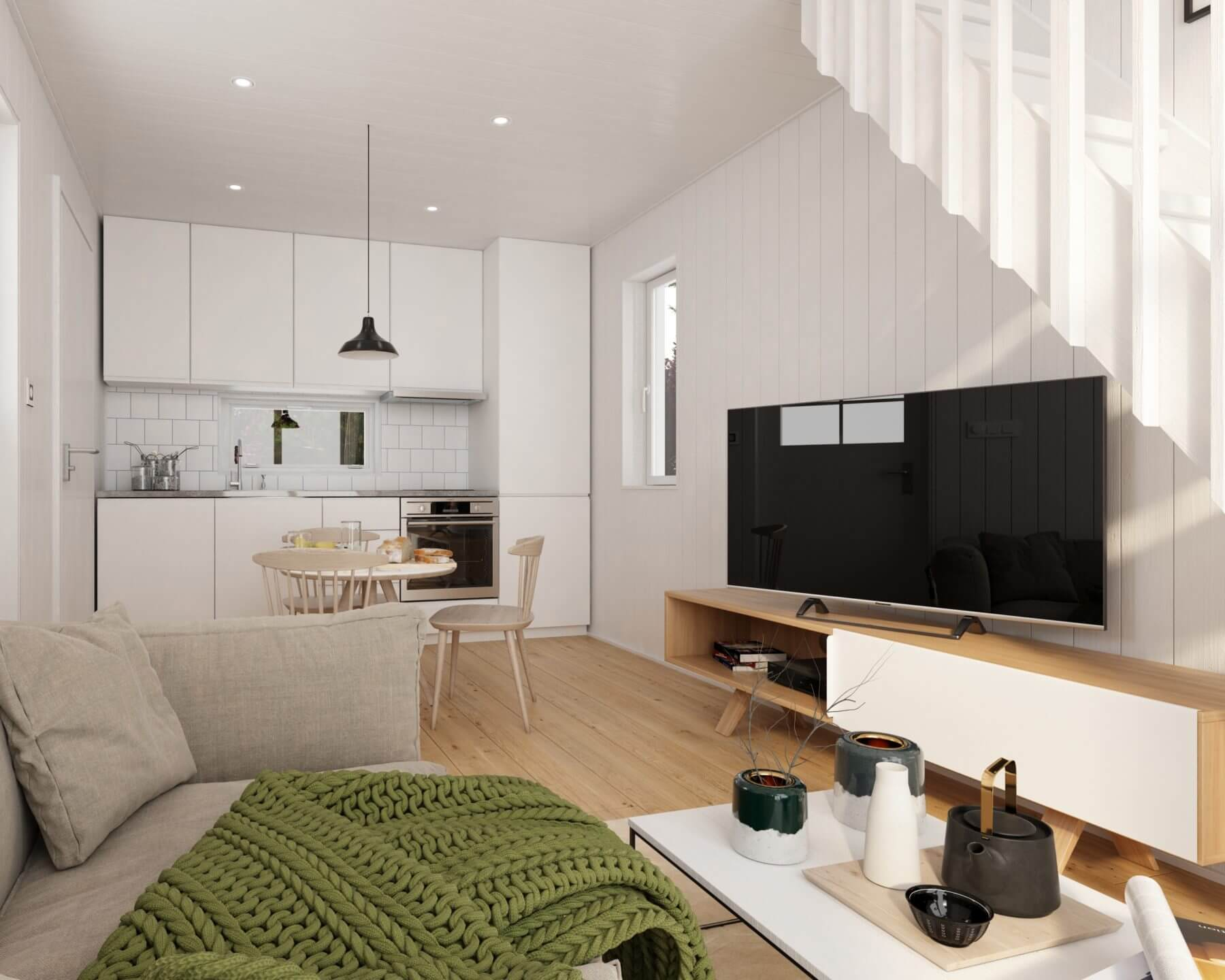 Kombinerat vardagsrum och kök i Attefallshus med pulpettak
