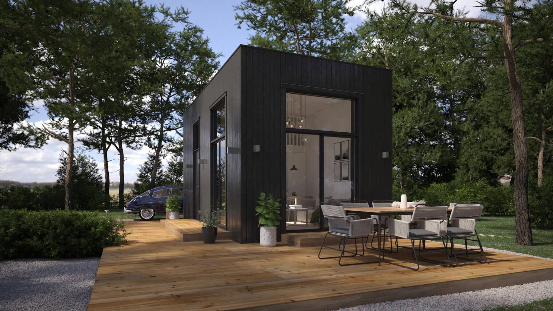 Attefallshus med svart exteriör och rakt tak och panoramafönster