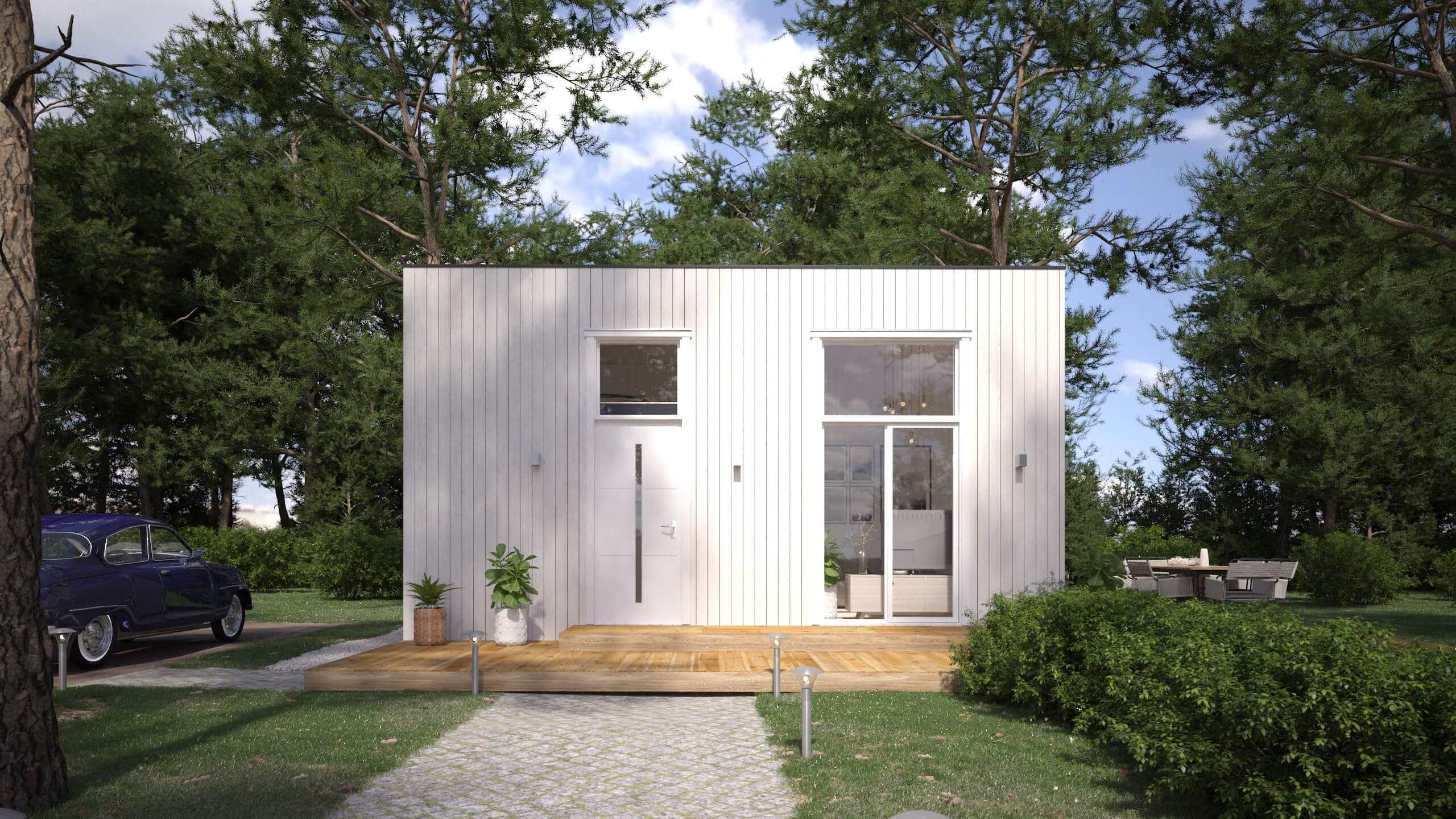 Attefallshus med vit exteriör och rakt tak och panoramafönster