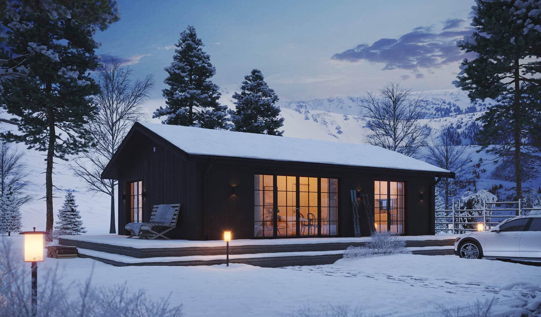 Fritidshus Klassisk 70.2 i svart fasad stående i snö under vinter