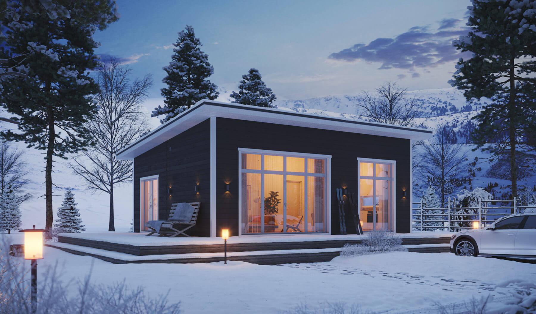 Fritidshus Pulpet 60.2 med svart fasad och med vita knutar stående i vinterväder