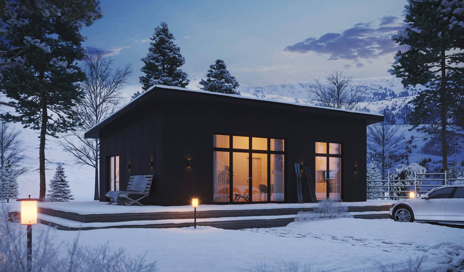 Fritidshus Pulpet 70.2 med svart fasad stående i vinterväder