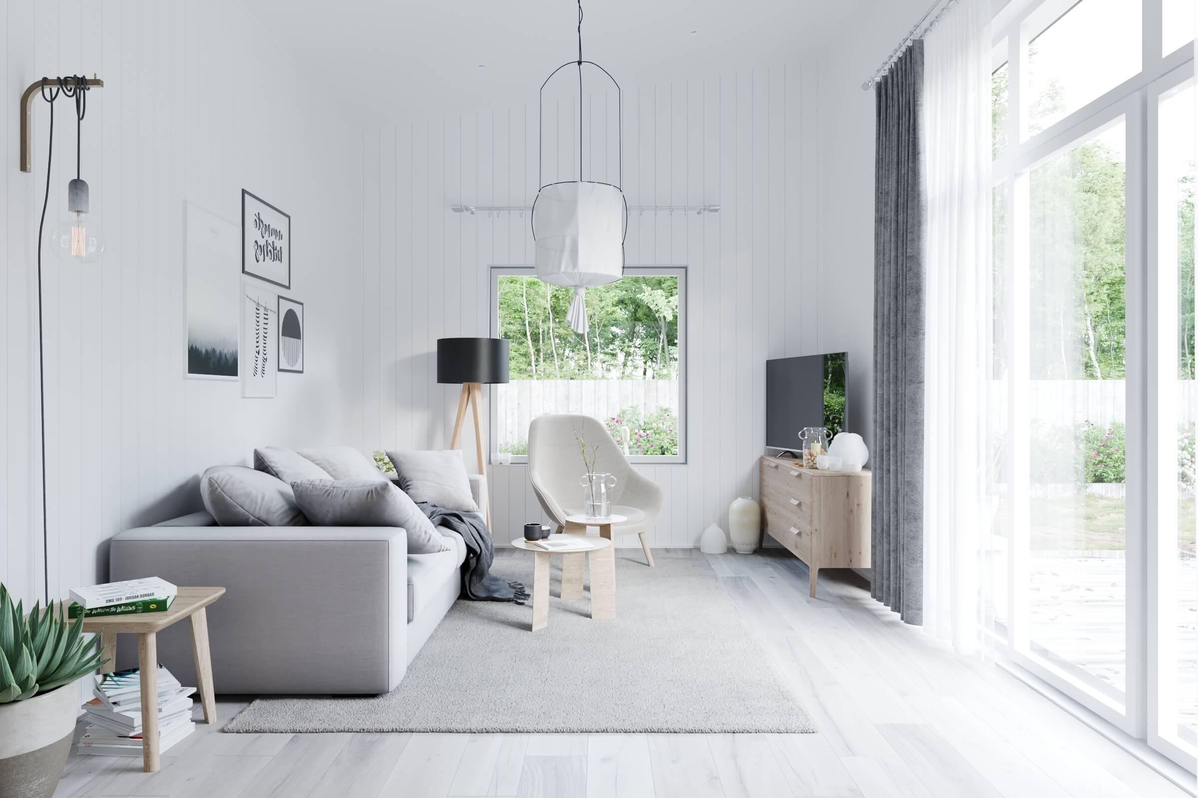Vardagsrum med soffa, soffbord, fåtölj tv och stort fönsterparti