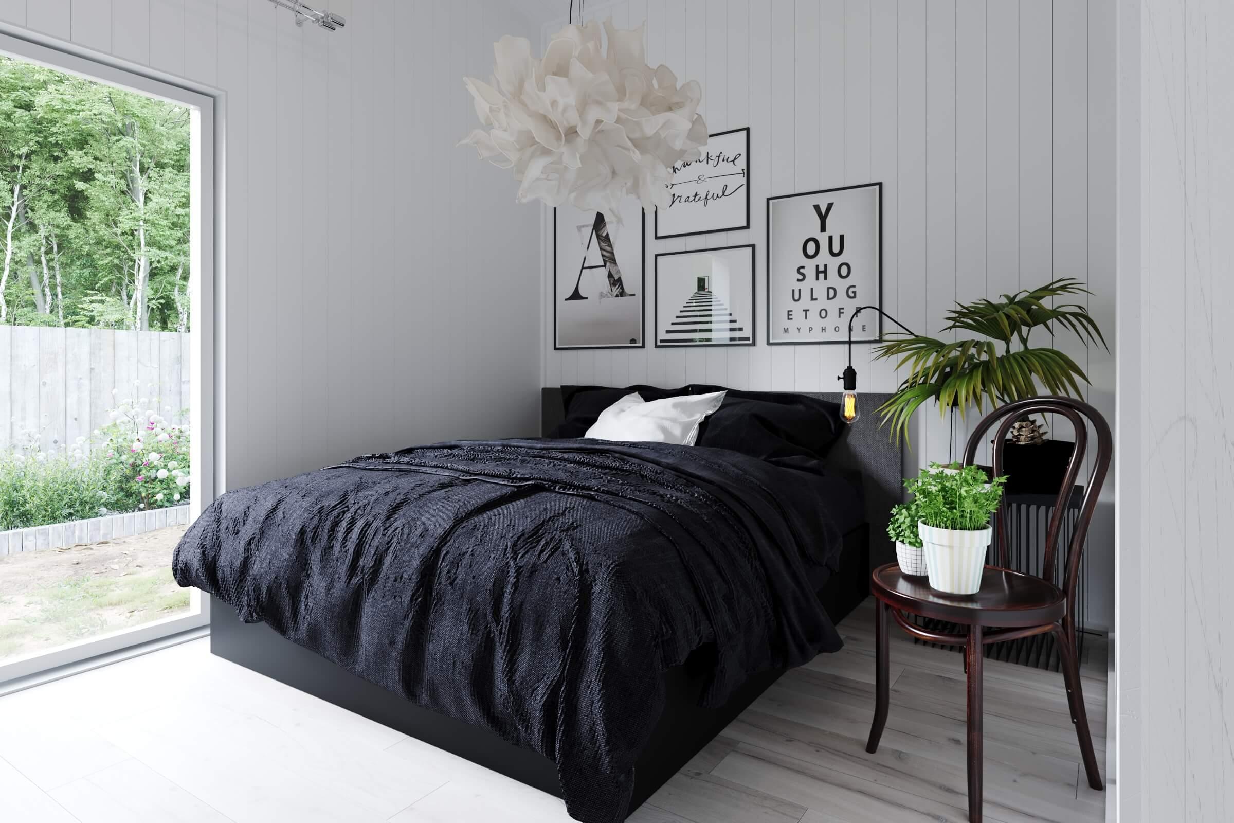 Ljust sovrum med dubbelsäng och tavlor